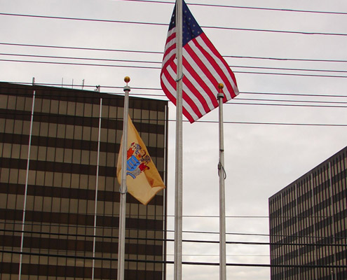 Aerial Signs and Awnings FLAGPOLES Home